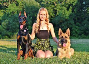Girl with 2 German shepherds